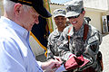 Defense.gov News Photo 110606-D-XH843-016 - Secretary of Defense Robert M. Gates signs a Texas A M flag for soldiers during his visit to a Forward Operating Base in Afghanistan on June 6.jpg