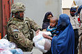 Defense.gov News Photo 120327-A-HQ885-001 - U.S. Army 1st Sgt. Herbert Duvernay with Headquarters and Headquarters Company 11th Tactical Theater Signal Brigade Task Force Signal volunteers.jpg