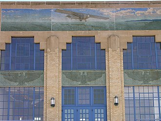 Kansas Aviation Museum - Bas-relief of the Spirit of St. Louis crossing the Atlantic above entrance on the northwest side