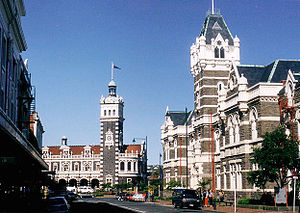 Bluestone - Dunedin Railway Station (centre) and Law Courts (right), showing dark bluestone and creamy Oamaru stone construction.
