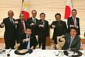 Duterte and Abe with Philippine Delegation 20161026.jpg