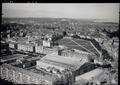 ETH-BIB-Genf = Genève, Plainpalais, Temple de Plainpalais, Palais de l'Exposition aus 100 m-Inlandflüge-LBS MH01-007925.tif