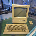 Early Apple Macintosh with keyboard and mouse in museum.jpg