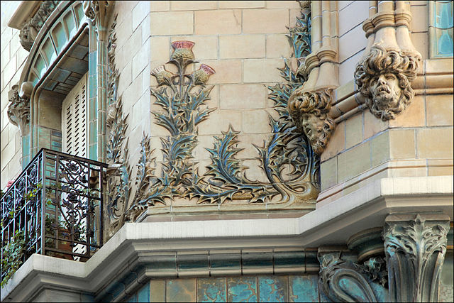 Thistles and curve-lined mascarons in decoration of Les Chardons building by Charles Klein in Paris, built in 1903