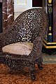 Elaborately carved Indonesian chair (39195652774).jpg