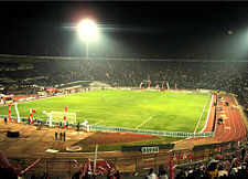 Estadio Nacional at night.