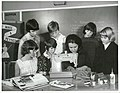 Evans Bay Intermediate – Demonstrating use of Electric sewing machines – Girls are wearing things of approval made in class (1968) (28128328046).jpg