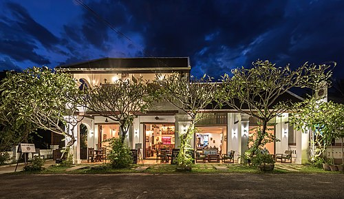 Exterior facade of Residence Bassac at blue hour, town of Champasak, Laos
