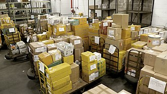 Packages awaiting inspection at the International Mail Facility in JFK airport FDA and the International Mail Facilities (IMFs) (40886549732).jpg
