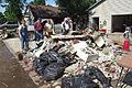 FEMA - 35766 - Resident with a debris pile in Iowa.jpg