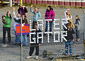 Families and friends wave goodbye to the amphibious dock landing ship USS Carter Hall (LSD 50) as it departs Joint Expeditionary Base Little Creek-Fort Story, Va., March 11, 2013, for a scheduled deployment 130311-N-XZ031-063.jpg