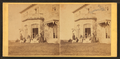 Family posing in front and in the balcony of stone house, from Robert N. Dennis collection of stereoscopic views 13.png