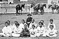 Father Damien with the Kalawao Girls Choir, at Kalaupapa, Molokai, circa 1878.jpg