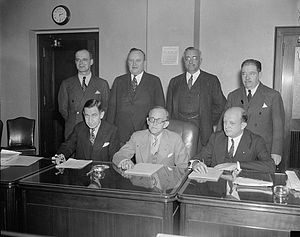 Federal Communications Commission -  Federal Communications Commission seen in Washington, D.C., in 1937. Seated (l-r) Eugene Octave Sykes, Frank R. McNinch, Chairman Paul Atlee Walker, Standing (l-r) T.A.M. Craven, Thad H. Brown, Norman S. Case, and George Henry Payne.