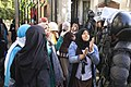 Female Islamist students and police - protest at Al-Azhar University Cairo 11-Dec2013.jpg
