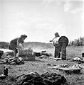 Finnish women doing laundry using a crank-operated washing machine, 1949.jpg