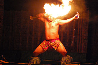 Fire performance - A fireknife performer with a fire knife