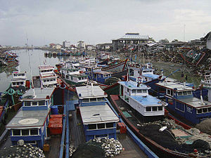 Surviving fishing boats clustered together in ...