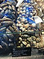 Fiskebryggen, Mathallen, Fishmarket, Bergen, Norway 2018-03-16. Mytilus edulis (blåskjell), Cardiidae (vongole, hjerteskjell), etc. displayed for sale at Fjellskål seafood store.jpg