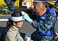 Flickr - Official U.S. Navy Imagery - A Sailor helps a simulated patient during a drill..jpg