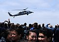 Flickr - Official U.S. Navy Imagery - A helicopter lands during an air show as part of a tiger cruise for family and friends of the crew..jpg