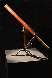 Achromatic telescope on folding tripod.