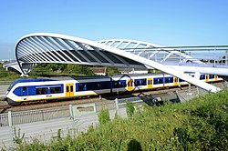 Foot-bicycle-bridge over the railway in Houten with Sprinter train of NS - panoramio.jpg