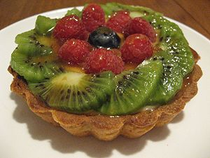 Fresh fruit tart with kiwi, raspberries, and b...