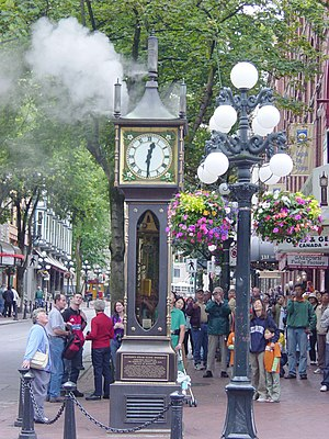 Gastown - Tourists entertained by the Gastown steam clock in Vancouver