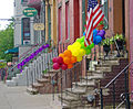 Gay pride balloons and ribbon on stoop railings, Lark Street, Albany, NY.jpg