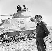 General Montgomery stands beside a Grant command tank near Tripoli, 27 January 1943. E21701.jpg
