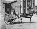 Geo. H. Holzbog horse-drawn street cleaning cart. Jeffersonville, Indiana. - NARA - 285559.tif