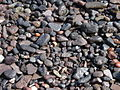 Gravel on a beach in Thirasia, Santorini, Greece.jpg