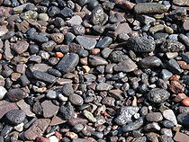 Gravel on a beach in Thirasia, Santorini, Greece.jpg
