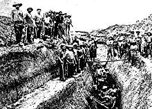 Large group of men filling a picture of a mining field.