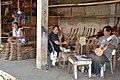 Guitar artisans at work (9237843070).jpg