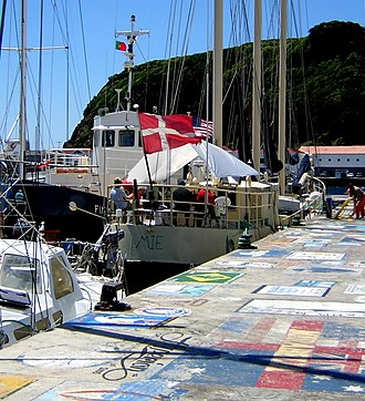 "Horta, Azores - The pier and seawalls in Horta Harbor and Marina are covered with the ""calling cards"" of visiting yachts."