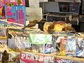 Huismus bij krantenwinkel.jpg