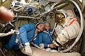 ISS-22 Maxim Suraev and Oleg Kotov with Orlan spacesuits.jpg
