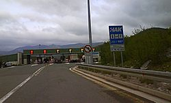 Six lane toll plaza with variable traffic signs placed above the toll plaza gates