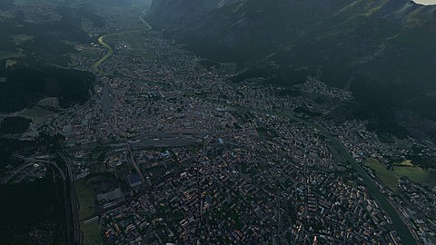 View over Innsbruck valley, Austria showing buildings, roads, and objects generated from OSM data. This is from the 1st build of OSM data for the entire world in FlightGear 2020 .