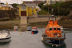 Ballycotton lifeboat station dates from 2002. The Trent class boat Austin Lidbury is at its moorings in the harbour.