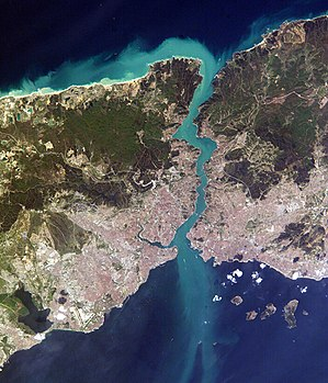 Bosphorus - Close-up satellite image of the Bosphorus strait, taken from the ISS in April 2004. The body of water at the top is the Black Sea, the one at the bottom is the Marmara Sea, and the Bosphorus is the winding waterway that connects the two. The western banks of the Bosphorus constitute the geographic starting point of the European continent, while the banks to the east are the geographic beginnings of the continent of Asia. The city of Istanbul is visible along both banks.