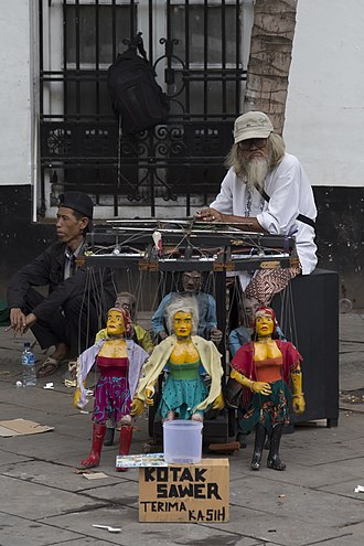 Puppeteer - A puppeteer in old town Jakarta