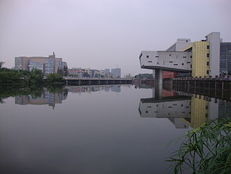 Sichuan University - Jiang'an Campus of Sichuan University. In this photo we can see the Ming-yuan Lake and the 1st teaching building, the Jiang'an Library of SCU around it.