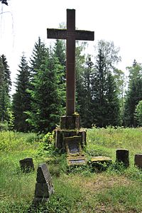 Jindřichovice war cemetery cross with tombstones.jpg