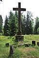 Jindřichovice war cemetery cross with tombstones.jpg
