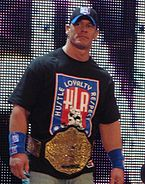 John Cena avec sa ceinture du World Heavyweight Championship. (2009)