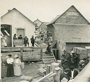 Jones Island, Milwaukee - Jones Island Docks; the 2 women were school teachers waiting for the boat back to mainland Milwaukee, 1912.