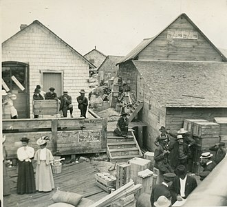 Jones Island, Milwaukee - Jones Island Docks; the 2 women were school teachers waiting for the boat back to mainland Milwaukee, 1912.